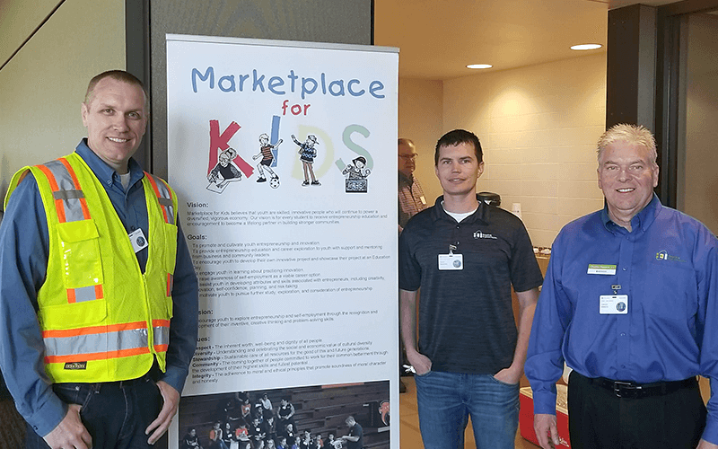 HEI's employees educate students about land surveying