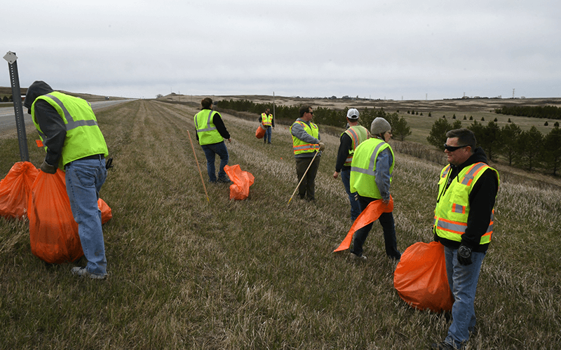 Volunteers filled 90 bags of garbage along the highway.