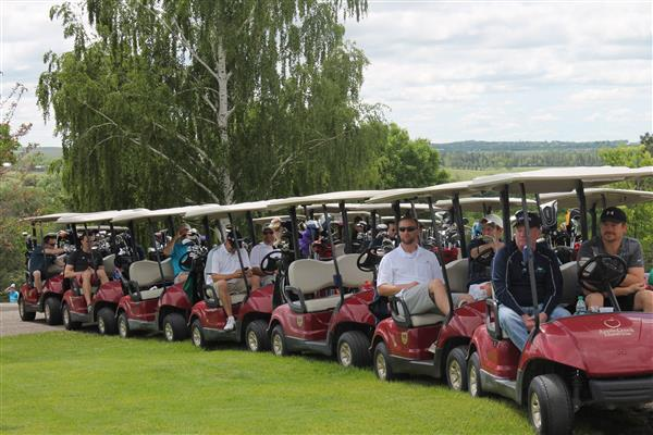 Golf carts ready to tee off for HEI's annual golf tournament